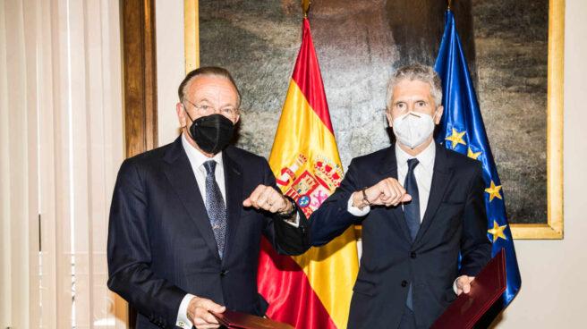 Grande-Marlaska y Fainé firman acuerdo programa Reincorpora